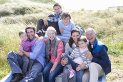 Family sitting in boat, smiling, portrait royalty free stock images