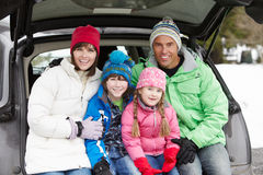 Family Sitting In Boot Of Car stock image