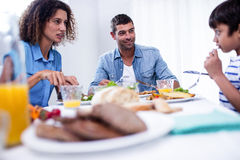 Family sitting at breakfast table Stock Photos