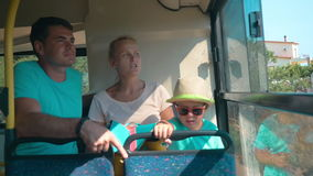 Family Sitting in a Bus stock footage