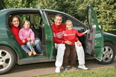 Family sitting in car royalty free stock photography