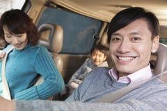 Family sitting in car, Beijing Stock Photos