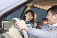 Family sitting in car, Beijing Royalty Free Stock Photography