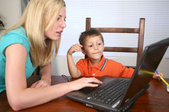 Family sitting at computer Royalty Free Stock Photo