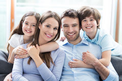 Family sitting on couch Royalty Free Stock Images