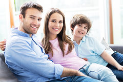 Family sitting on couch Stock Image