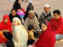 Family sitting in a courtyard of Jama Masjid, Delhi Stock Photo