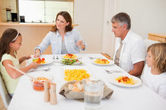 Family sitting for dinner Stock Photography