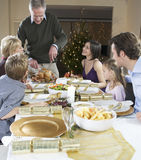 A family sitting down for Christmas dinner Royalty Free Stock Photos