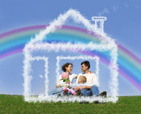 Family sitting in dream house and rainbow collage Royalty Free Stock Photography