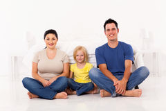 Family sitting on floor Stock Photos