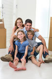 Family sitting on floor in new house stock photography