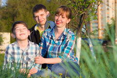 Family sitting on the grass in the park Stock Images