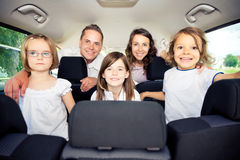 Family Sitting Inside Their Car royalty free stock images