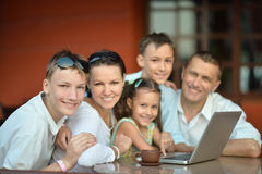 Family sitting with laptop Stock Images