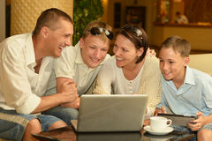 Family sitting with laptop Stock Image