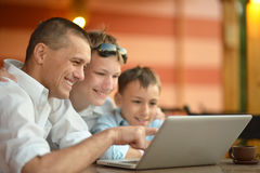 Family sitting with laptop Stock Photo
