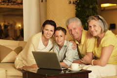 Family sitting with laptop royalty free stock photo