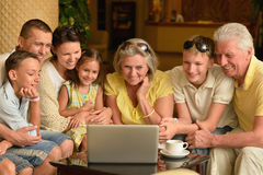 Family sitting with laptop Stock Photography
