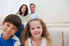 Family sitting in the living room Stock Photography