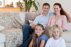 Family sitting in the living room Stock Photo