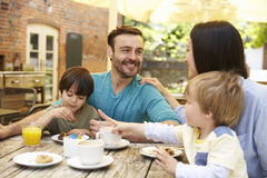 Family Sitting At Outdoor Cafe Table Having Lunch Royalty Free Stock Photos