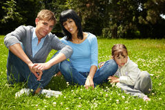 Family sitting in park Royalty Free Stock Image