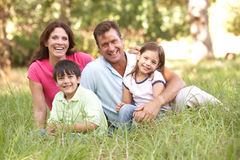 Family Sitting In Park Royalty Free Stock Photography