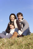 Family Sitting In Park Royalty Free Stock Photo