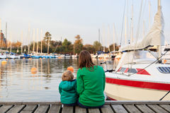 Family sitting on pier Stock Photography