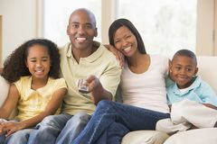 Family sitting in room with remote control Royalty Free Stock Photo