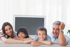 Family in sitting room smiling at camera Stock Photo