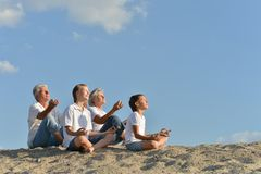 Family sitting on a sand Stock Images