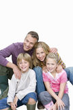 Family sitting, smiling, portrait, cut out. Family sitting smiling portrait, cut out royalty free stock images