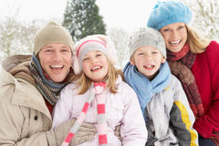 Family Sitting In Snowy Landscape Stock Images