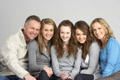Family Sitting On Sofa Stock Photography
