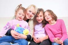 Family sitting on sofa Stock Photography
