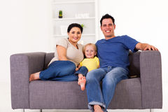 Family sitting on sofa Royalty Free Stock Photos