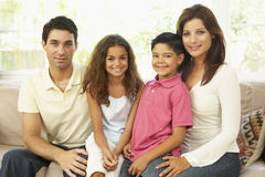 Family Sitting On Sofa At Home Stock Image