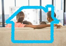 Family sitting on sofa at home against home outline in background Stock Images