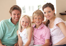 Family Sitting On Sofa At Home Together Stock Photography