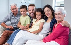 Family sitting on sofa stock image