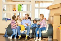 Family sitting on sofa, relocation. Royalty Free Stock Images