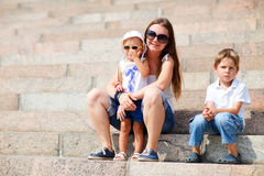Family sitting on steps outdoors Royalty Free Stock Photos