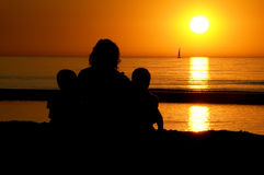 Family Sitting At Sunset Royalty Free Stock Photography