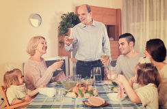 Family sitting at  table for dinner Stock Images