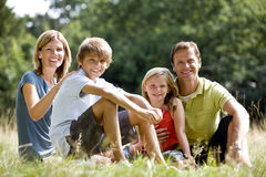 A family sitting together on the grass Royalty Free Stock Image