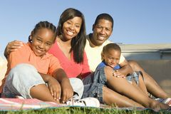 Family Sitting Together In Lawn Royalty Free Stock Photography