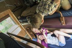 Family sitting in train compartment royalty free stock images