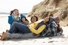 Family Sitting On Winter Beach Royalty Free Stock Photos